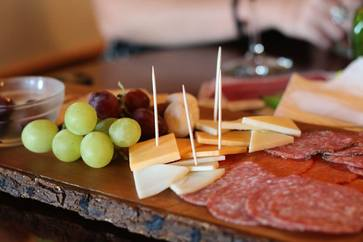 Meat, cheese, and grape platter